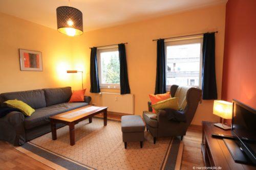 Wohnzimmer mit Schlafcouch – Ferienwohnung Hexenparadies
