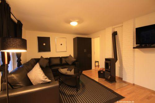Wohnbereich mit Kamin - Ferienhaus Alexander