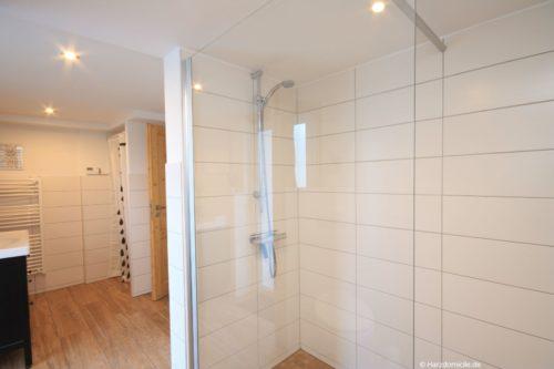 Badezimmer 1 mit Sauna - Ferienhaus Lauwenhaus