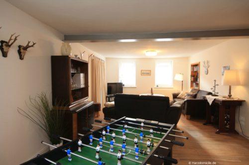 Wohnzimmer mit Kicker - Ferienhaus Lauwenhaus
